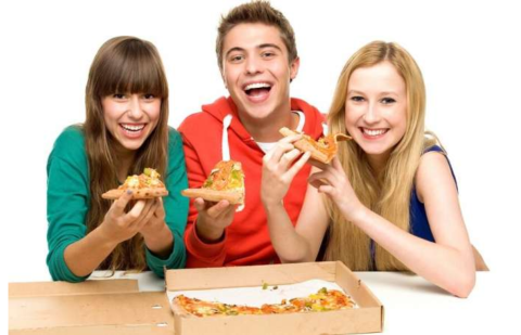 Pizza Near IUP - College students eating pizza out of the box and laughing against an all white background