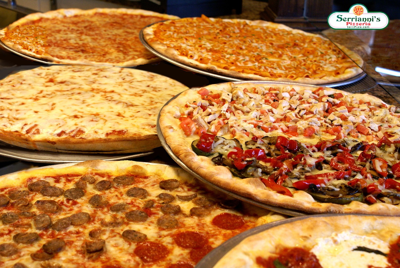 A delicious looking assortment of 6 pizza
